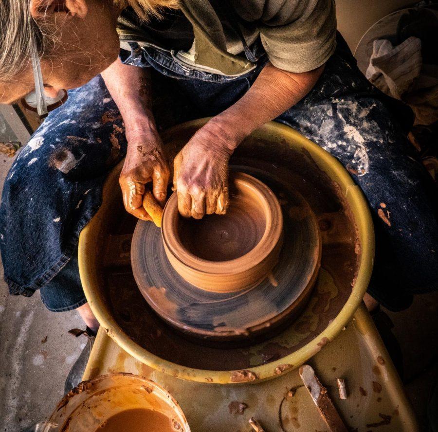 Hands on potters wheel