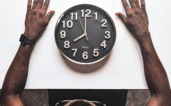 Student looking at clock